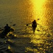 man and woman kayaking at sunset — Stock Photo