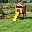 Back Yard Wooden Swing Set - Stock Photo