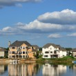 Suburban Executive Homes on Lake - Stock Photo