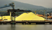 Piles of Yellow Sulphur on Dock — Stock Photo