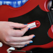 Playing Guitar Video Controller — Stock Photo