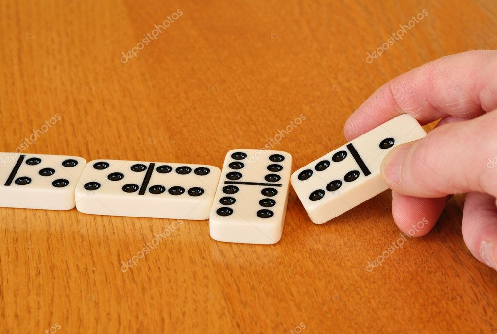 Playing Dominoes on a wood table — Stock Photo #2294424