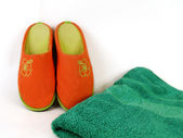 Carpet slippers and towel — Stock Photo