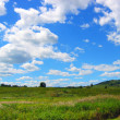 Stock Photo: Bright sky over plain
