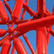 Red iron bar against blue sky — Stock Photo