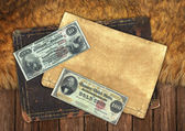 Vintage papers and money — Stock Photo