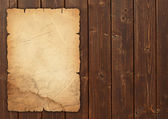 Vintage paper on wood — Stock Photo