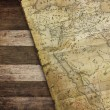 Vintage map on wood — Stock Photo