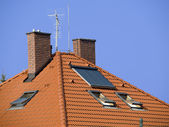 Roof with two chimneys and solar panel — Stock Photo