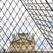 From inside the pyramid of Louvre museum - Stock Photo