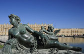 Statue artwork and Versailles palace — Stock Photo