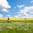 Woman on meadow - Stock Photo