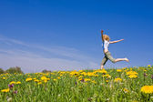 Young woman having fun on meadow — Stock Photo