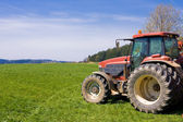 Tractor on meadow — Stock Photo