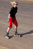 Young woman on rollerskates — Stock Photo