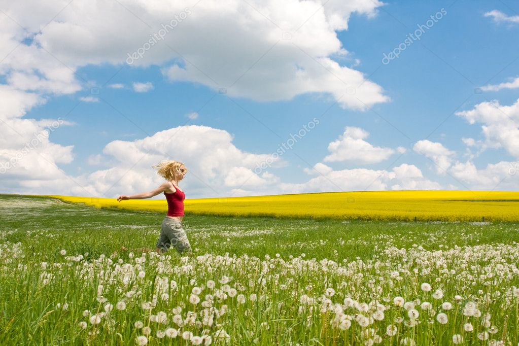 Young female on a flowery meadow — Stock Photo #2315853