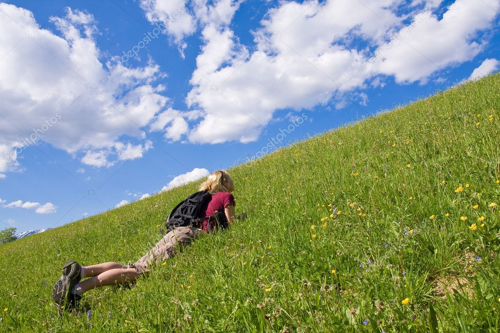 Young female on a meadow in the mountainous landscape — Stock Photo #2343994