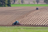 Tractor plowing filed — Stock Photo