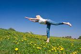 Young woman exercising yoga — Stock Photo