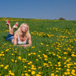 Young woman lying on a meadow — Stock Photo #2478272