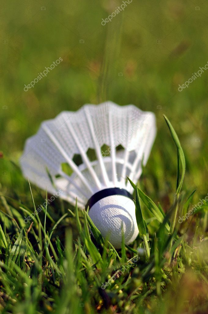 Badminton shuttlecock in the grass — Stock Photo #2432302