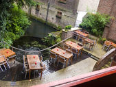 Belgium, Brugge, cafe over canal — Stock Photo