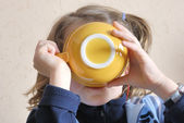 Girl drinking from bowl — Stock Photo