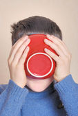 Boy drinking from bowl — Stock Photo