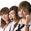 Stock Photo: Happy call center employees with headset