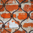 Stock Photo: Pattern of iron grid and brickwall backg