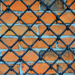 Pattern of iron grid and brickwall — Stock Photo