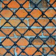 Pattern of iron grid and brickwall - Stock Photo