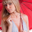 Stock Photo: Young pretty womwith red umbrella
