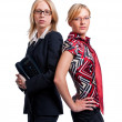 Two young cute business women - Stock Photo