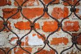Pattern of iron grid and brickwall backg — Stock Photo