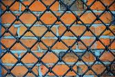 Pattern of iron grid and brickwall — Stock Photo