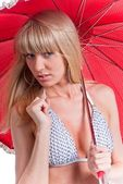 Young pretty woman with red umbrella — Stock Photo