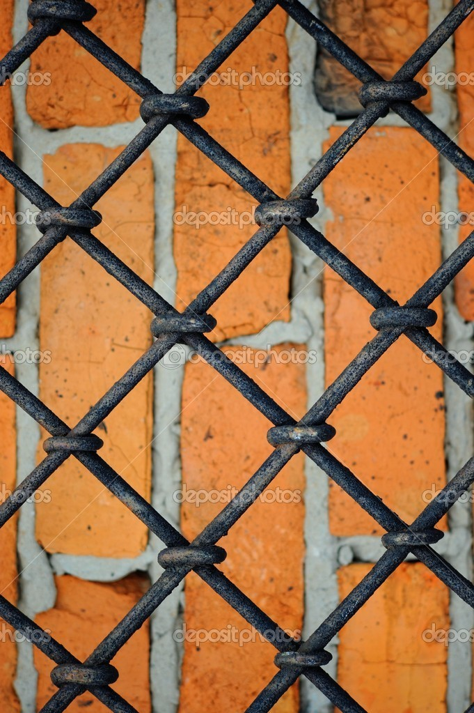 Pattern of iron grid and red brickwall background — Stock Photo #2147201