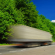 Heavy truck on duty. Motion blur - Stock Photo