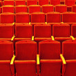 Stock Photo: Empty rows of red theatre seats