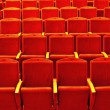 Empty rows of red theatre seats - Stock Photo