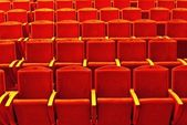 Empty rows of red theatre seats — Stock Photo