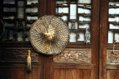 Door and bamboo hat — Stock Photo