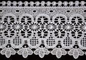 White lace over black background — Stock Photo