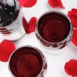Stock Photo: Wine and rose petals