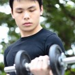Stock Photo: Young man working out