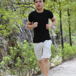 Foto Stock: Young man jogging