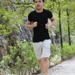 Stock Photo: Young man jogging