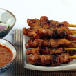 Постер, плакат: A plate of Chicken Satay