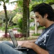 Stock Photo: Young musing laptop